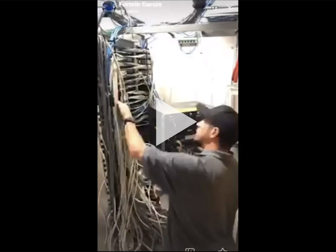 UITS tech connecting cables to new switches