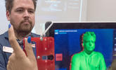 An image of a man being scanned for a 3D model