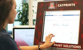 An image of a student using a CatPrints kiosk
