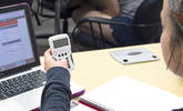 An image of a student using a classroom response device in class