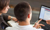 An image of a student viewing D2L on a laptop