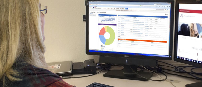 An image of a woman viewing the JIRA interface on her computer
