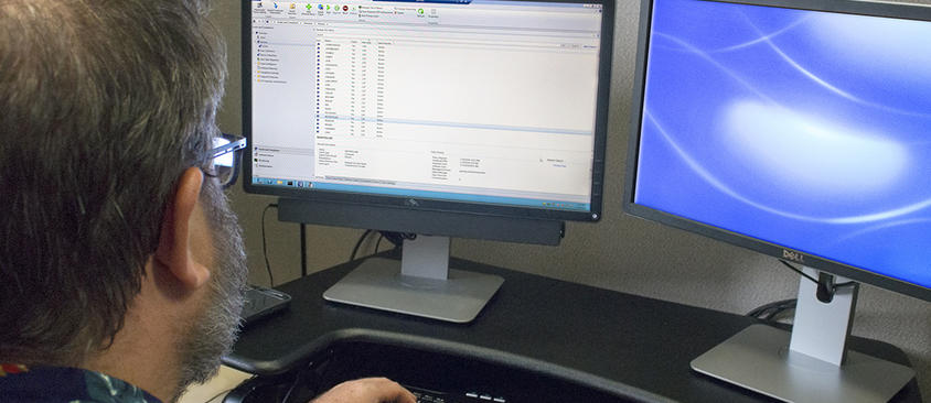 An image of a man working in the MSCCM interface