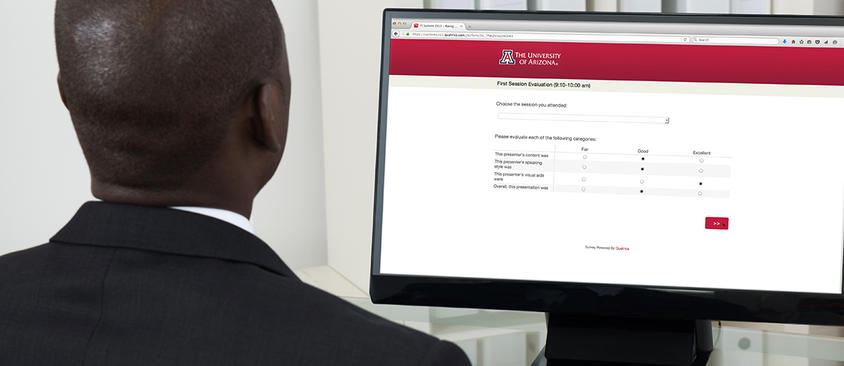 An image of a man taking an online survey