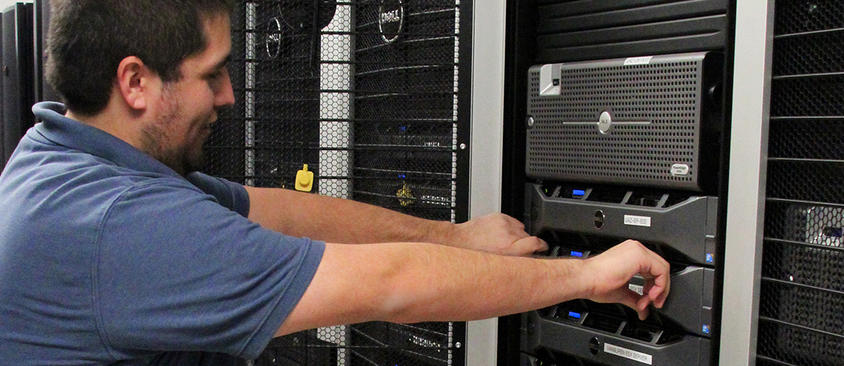 An image of a technician pulling a server out of a rack