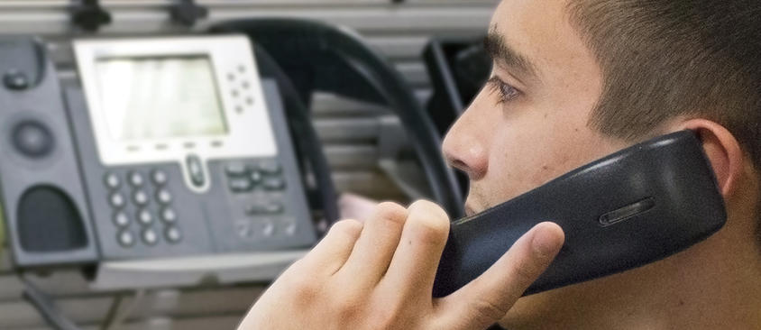 An image of a man on the phone