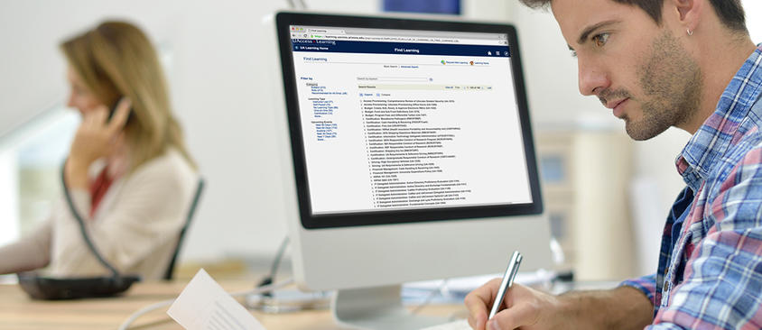 Image of a man working in UAccess Learning on his computer