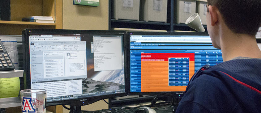 An image of a man viewing the Zabbix interface