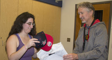 Ariella Gladstein accepts prize package from Research Data Center's Chris Reidy