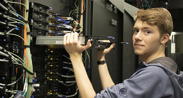 Alec Scott, a student worker in the RDC, replacing hardware in the El Gato system
