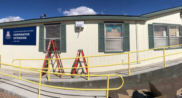 A wireless access point is added outside the Navajo County Cooperative Extension office in Holbrook