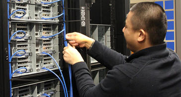 A tech from PCPC Direct installs new nodes in the Research Data Center